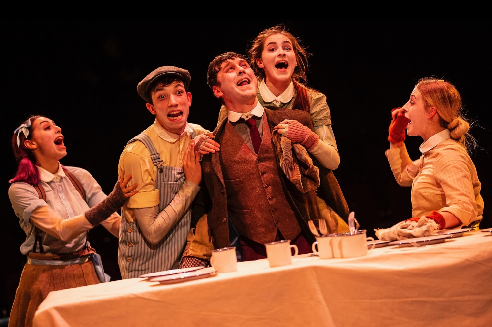 Craig Fairbairn as Bob Cratchit - centre with ensemble from Newcastle College